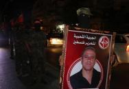 مسيرة وجنازة رمزية للشهيد عمر النايف بغزة